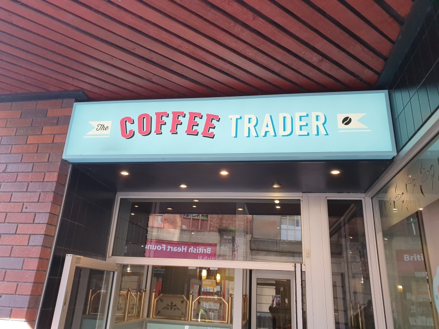 The Coffee Trader Sign